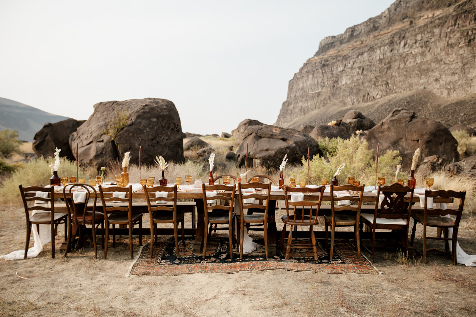 Farm tables from Rustique Rentals create intimate seating, and set the stage for our boho tableware rentals.
