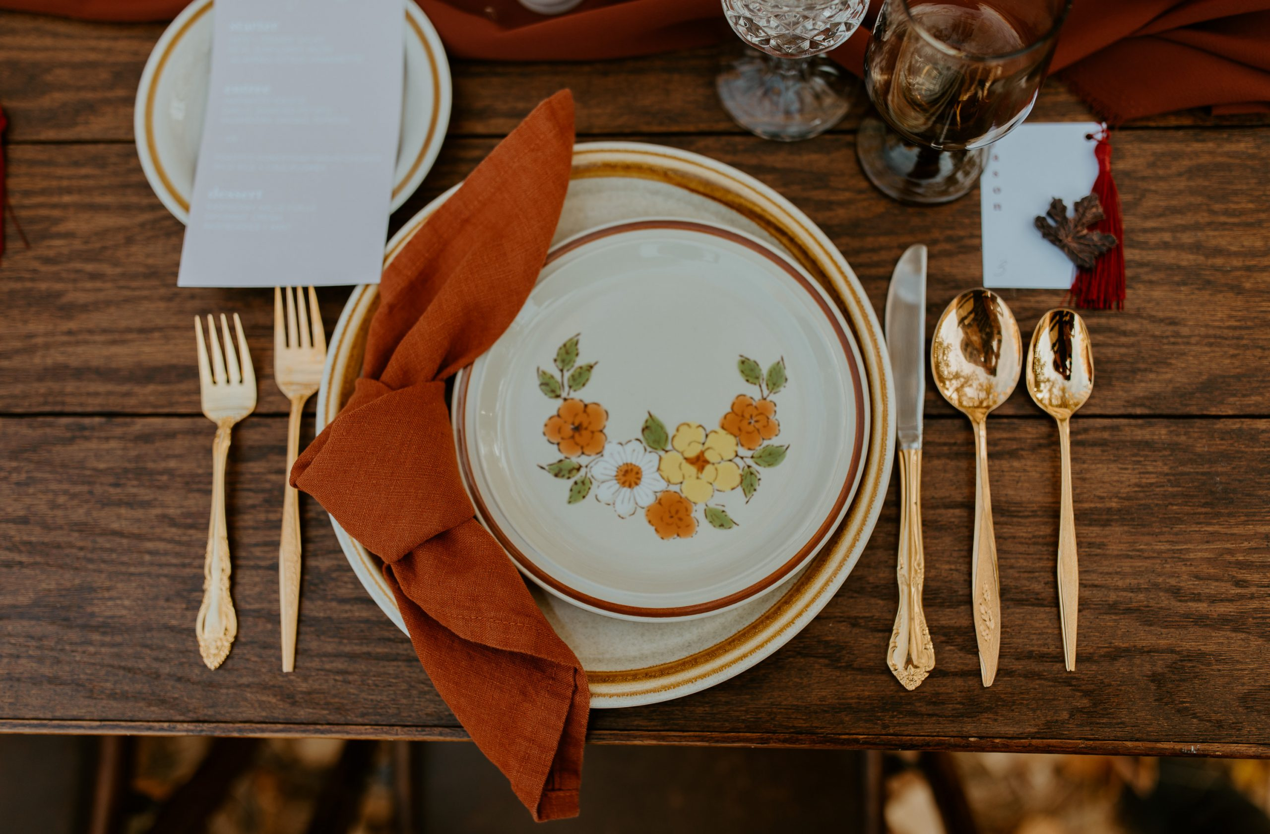 Our collection of mismatched stoneware rentals creates a vintage vibe in this muted autumn tablescape.