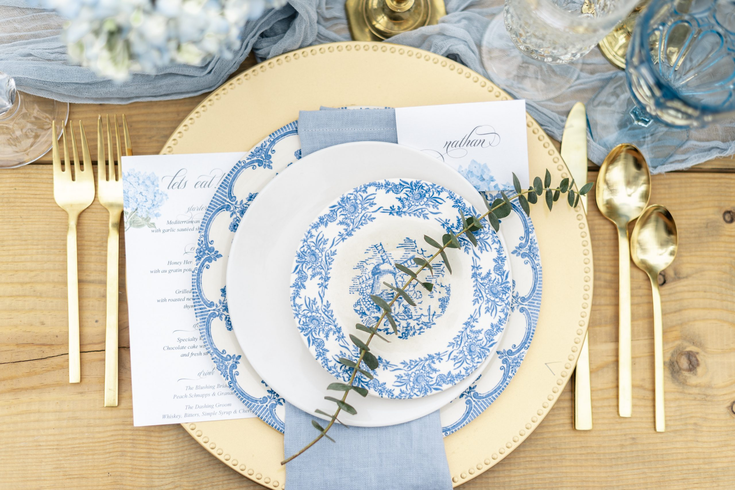 Designed by Wild Bliss & Co., this European inspired tablescape feels effortlessly timeless.