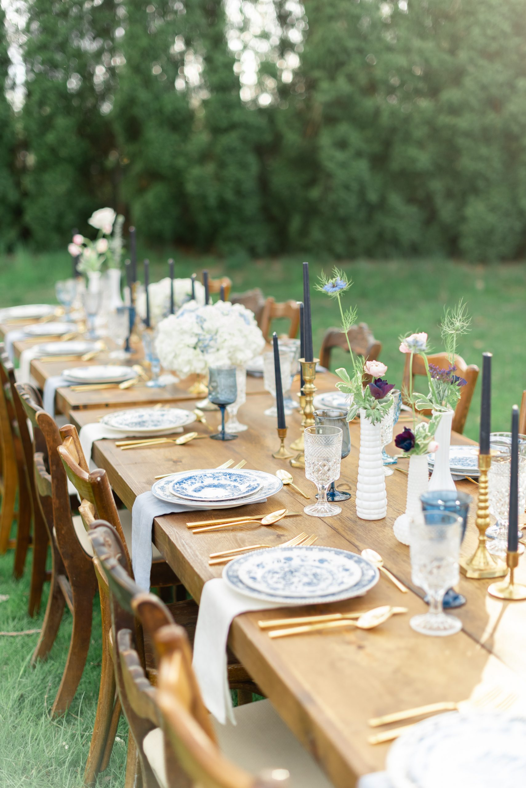 Farm tables by Rustique Rentals and dinnerware rentals by Flying China of Boise, Idaho.
