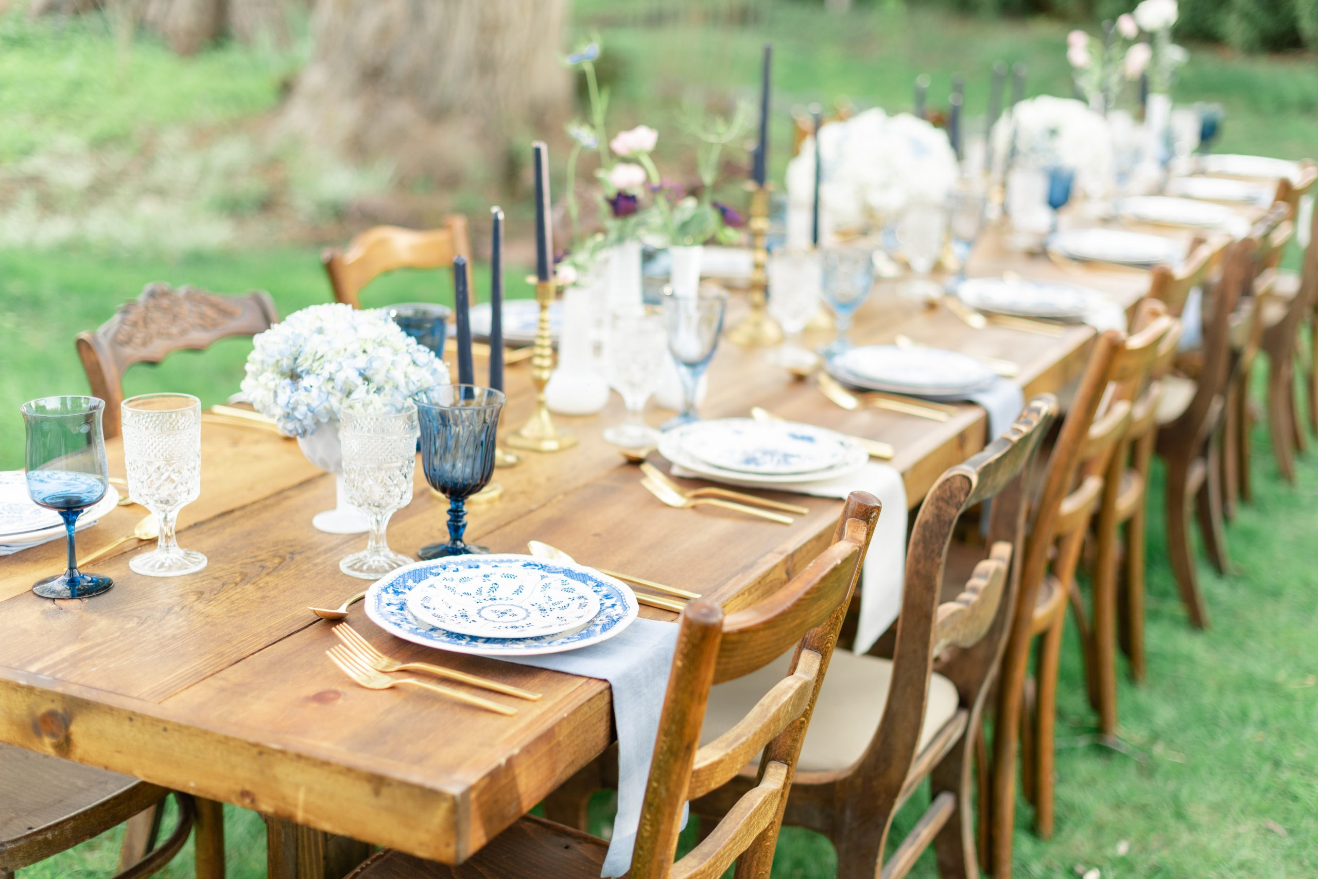 Our collection of mismatched blue glassware and blue and white china is paired with linen napkins of the same tones.